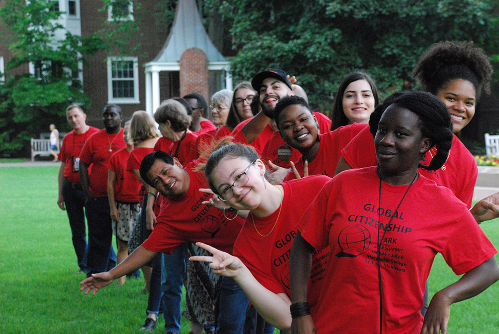 ARK people in red t-shirts on Macalester College lawn, summer 2019